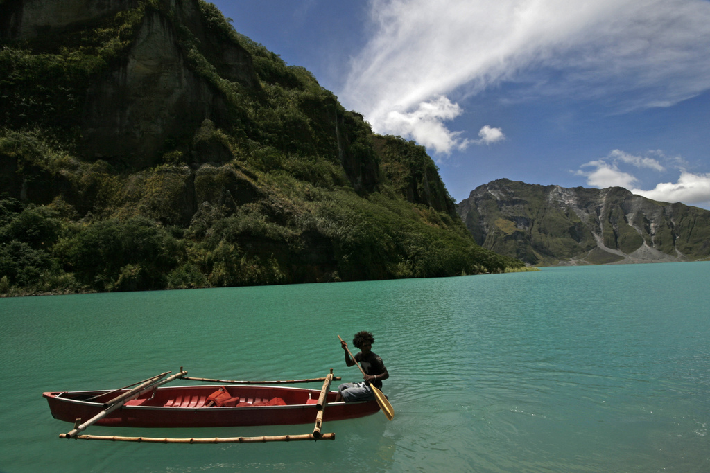 An Aeta boating in Lake Pinatubo