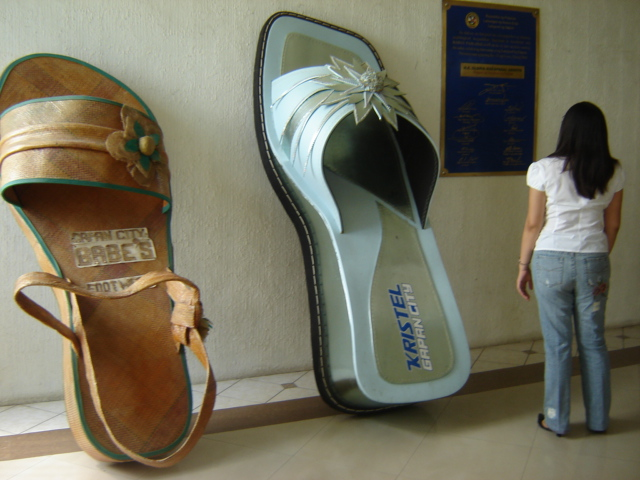 Giant sandals at Gapan City Hall Image source: Ian Dexter Marquez/Creative Commons